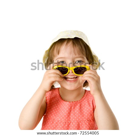 Little Girl holding sunglasses wearing panama isolated on white - stock photo