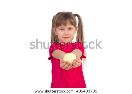 Little girl holding the ball in his hands