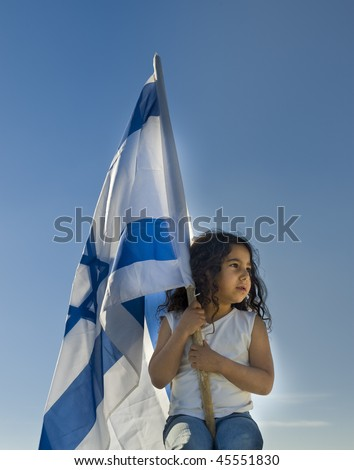 little girl holding the Israeli flag - stock photo