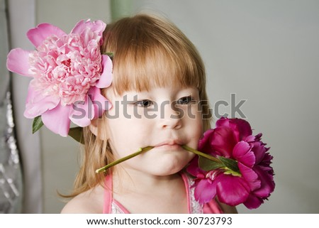 Little girl holding the red pion in her mouth - stock photo