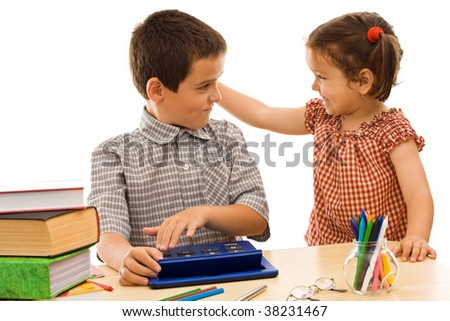 Little girl holding the schoolboy by the ear - isolated - stock photo