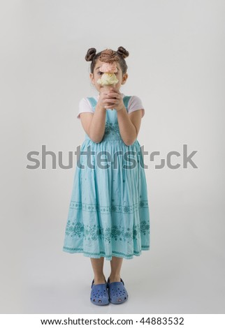 little girl holding three flavors ice cream scoops on cone