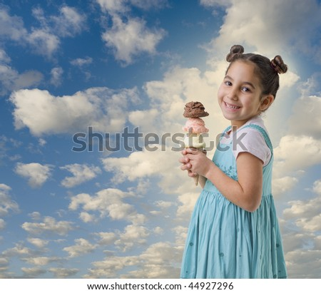 little girl holding three flavors ice cream scoops on cone with clouds