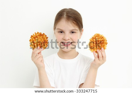 Little girl holding waffles - stock photo