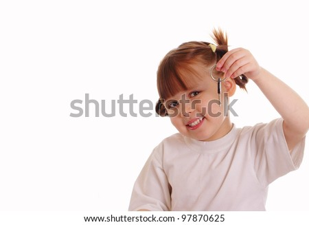 Little girl holds a key - stock photo
