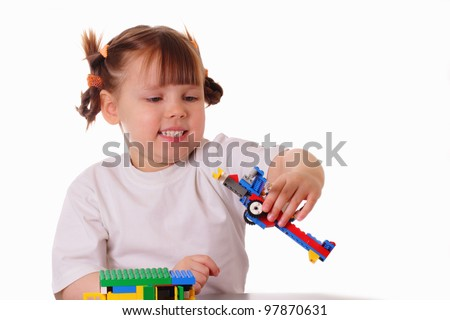 Little girl holds a toy airplane in her hand - stock photo