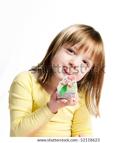 little girl holds piece of cake. isolated on white - stock photo