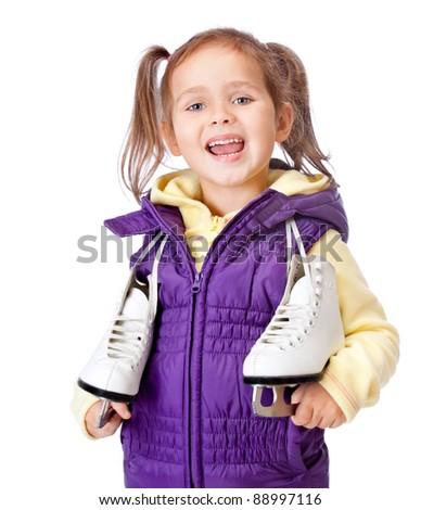 little girl holds skates on white background - stock photo