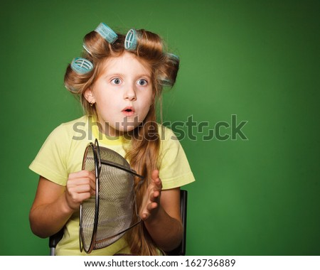 Little girl housewife with kitchenware play music and sing - stock photo