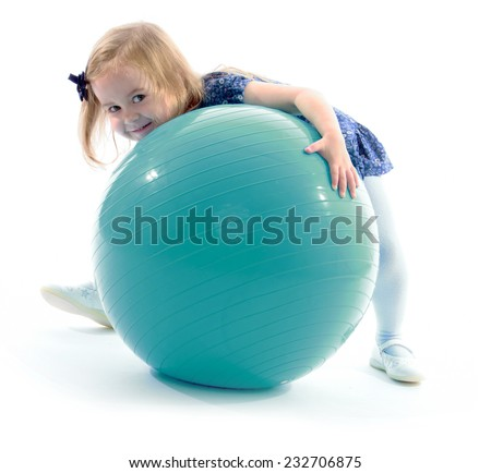 Little girl hugging a big ball.Isolated on white background. - stock photo