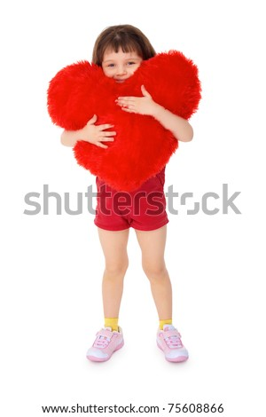 Little girl hugging a toy heart, isolated on a white background - stock photo