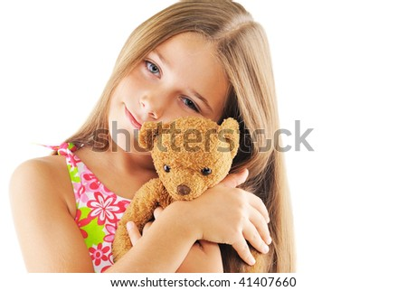 Little girl hugging bear toy. On white background - stock photo