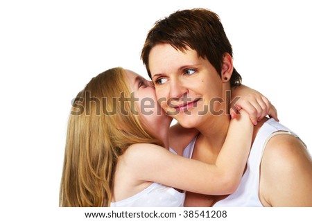 little girl hugging her mother - stock photo