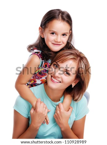 Little girl hugging her mother closeup portrait - white background