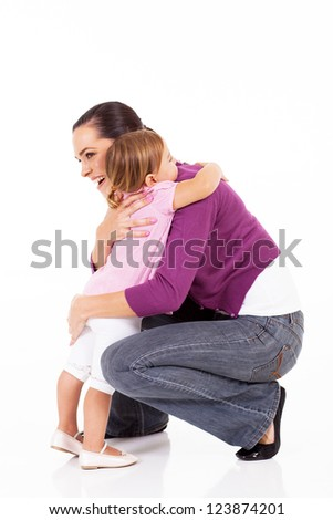 little girl hugging mother isolated on white