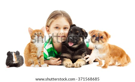 little girl hugging puppy and kitten on white background - stock photo
