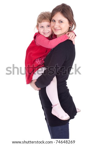 little girl hugging to mother, in her arms - stock photo