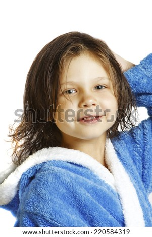 little girl in a bathrobe - stock photo