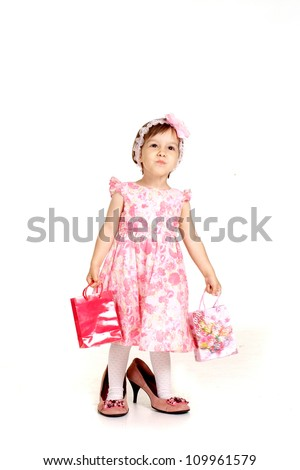 Little girl in a beautiful dress and big shoes - stock photo