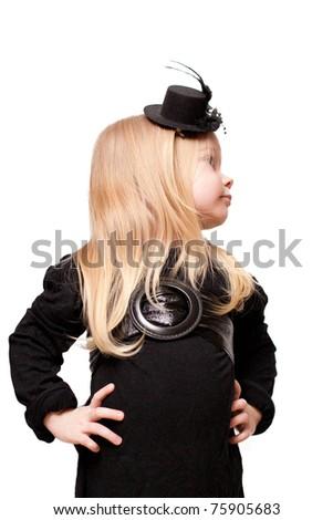 little girl in a black hat posing - stock photo