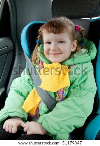 Little girl in a car - stock photo
