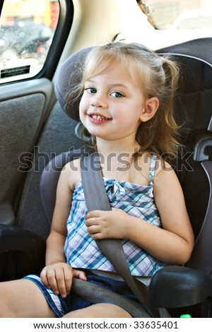Little girl in a car seat - stock photo