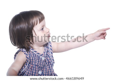 little girl in a checkered dress isolated on a white background shows his hand towards