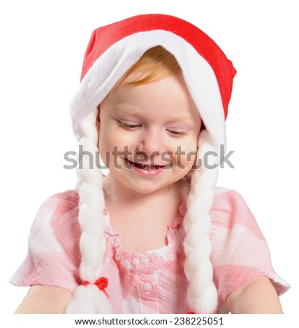 Little girl in a Christmas hat with braids. Isolated on white background.