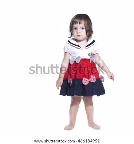 little girl in a dress isolated on a white background