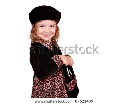 little girl in a dress with a leopard design