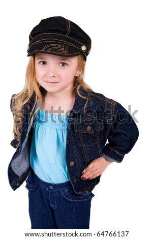 little girl in a jean jacket with her hands on her hips and smirk on her face
