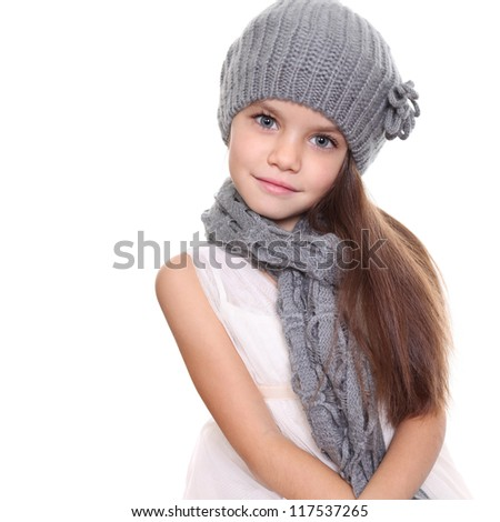 little girl in a knitted hat and gray scarf - stock photo