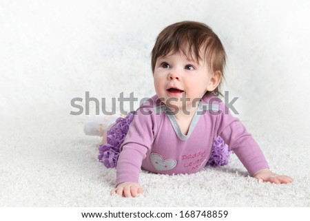 little girl in a lilac on a light background
