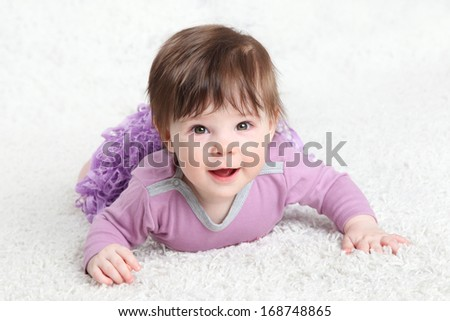 little girl in a lilac on a light background - stock photo
