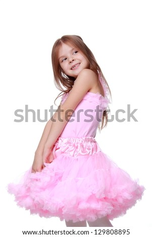 Little girl in a pink dress dancing