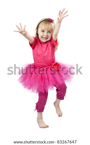 little girl in a pink dress dancing in studio isolated on a white background - stock photo