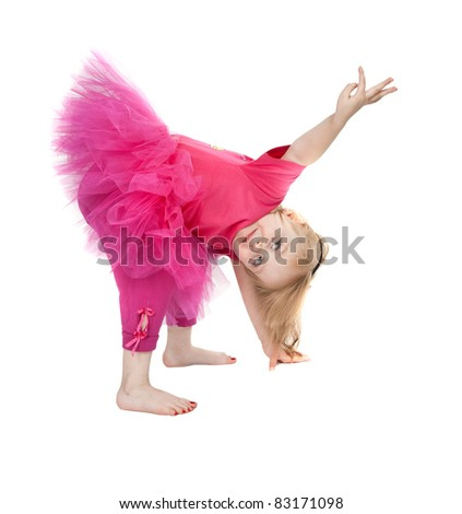 little girl in a pink dress dancing in the studio bow isolated on white background - stock photo