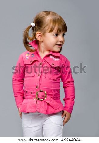 little girl in a pink jacket, poses for the photographer