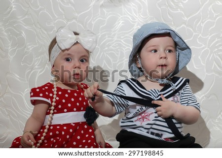 little girl in a red dress and a boy - stock photo