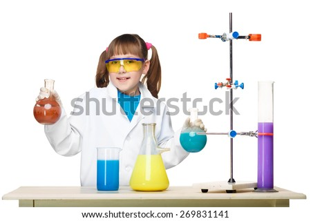 Little girl in a white coat as chemist doing experiment with multicolored chemical fluid in the laboratory isolated on white background
