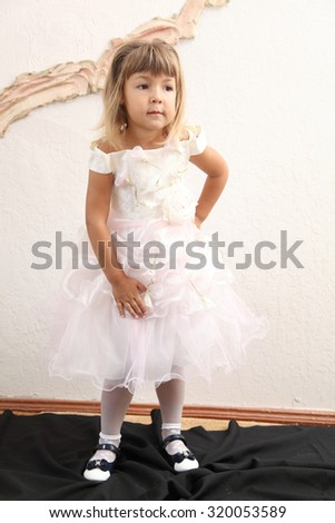 little girl in a white dress