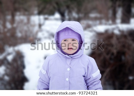 little girl  in a winter park with - stock photo