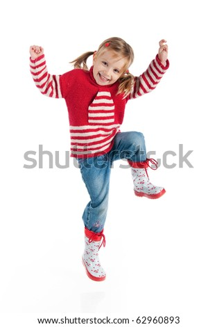 Little girl in autumn clothing jump  isolated on white