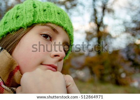 Little girl in autumn day