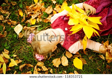 Little girl in autumn park (soft focus, focus on eyes of baby)