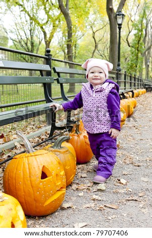 little girl in autumnal Central Park, New York City, USA - stock photo