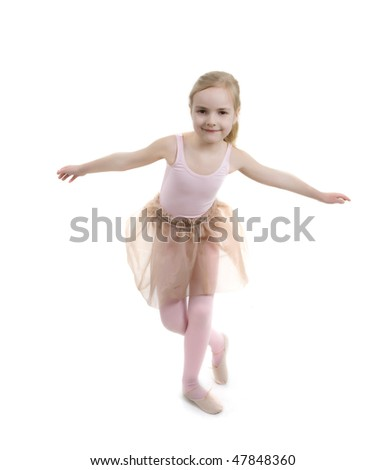 little girl in ballet clothes.  studio shot over white