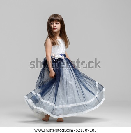 Little girl in beautiful dress portrait