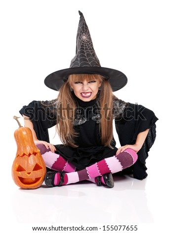Little girl in black hat with pumpkin, isolated on white background - stock photo