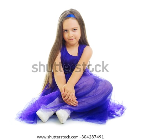 Little girl in blue dress isolated - stock photo